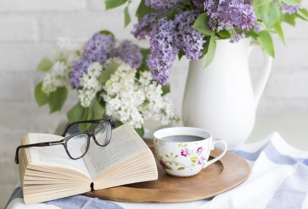 Reading and enjoying a warm drink are a great way to practice self care.