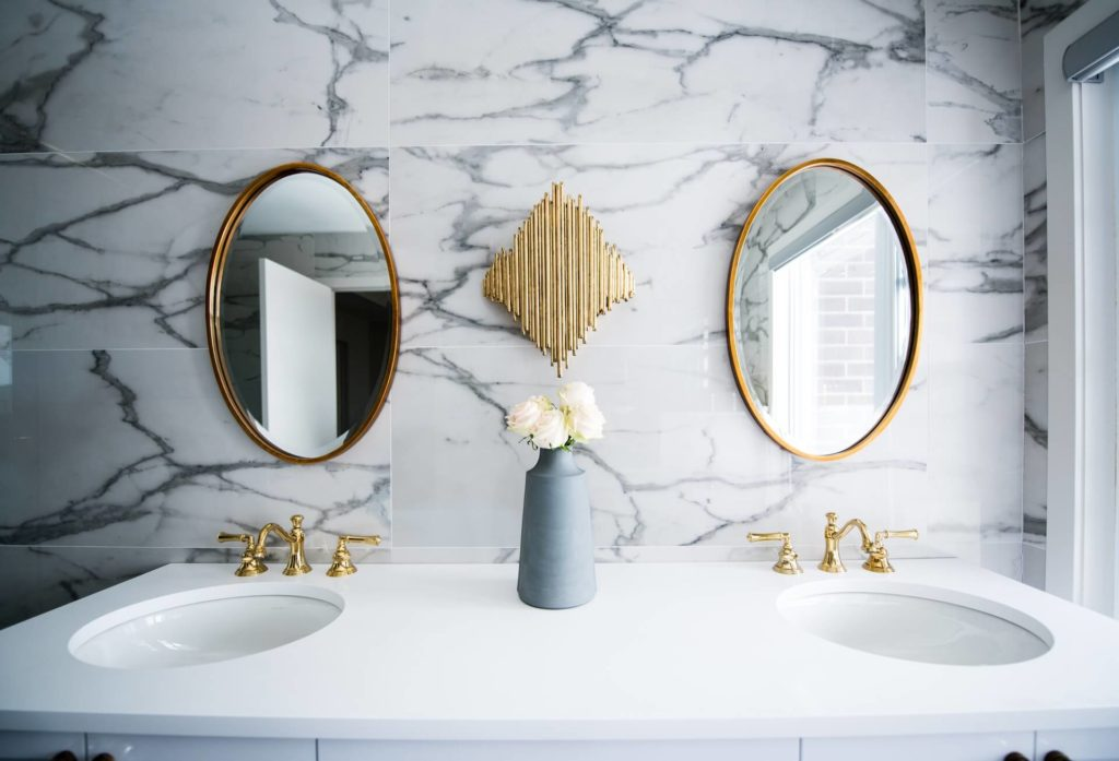 There are many things to get rid of in your bathroom for minimalist living.