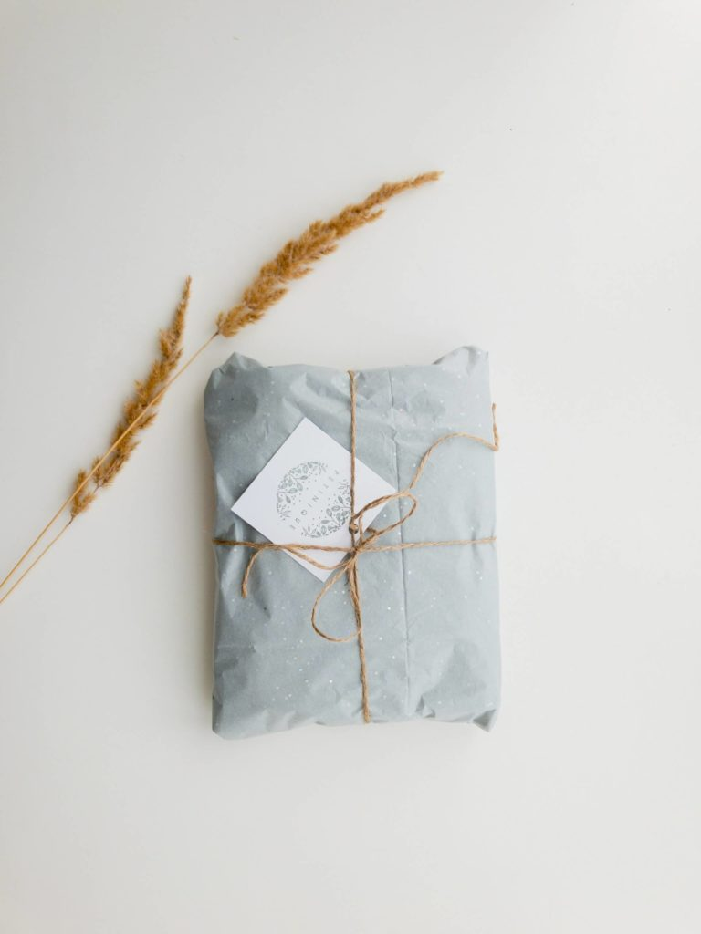 Reusing wrapping paper will help save trees and paper.