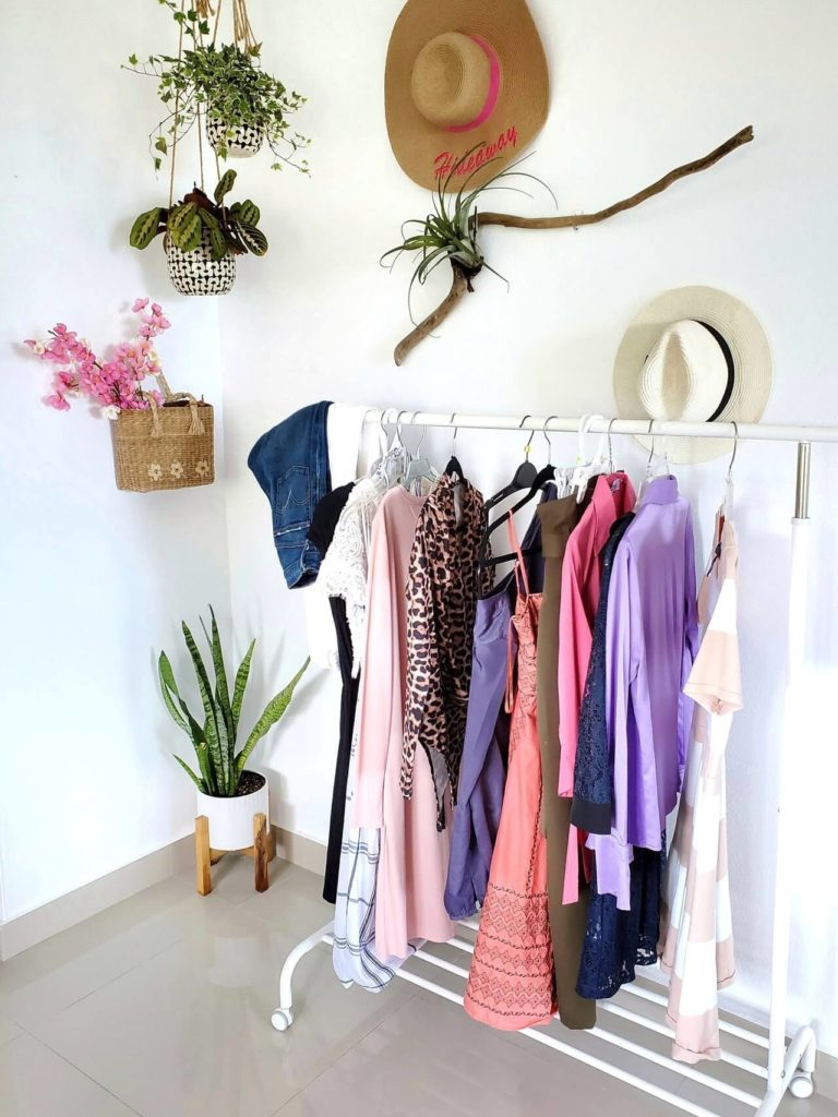 Having a tidy room during a closet declutter is the key to declutter clothes efficiently.